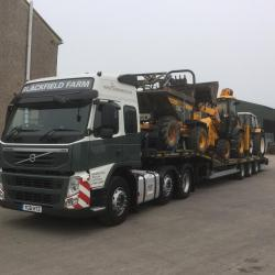 Load of construction equipment heading out to a job in Glasgow for local groundworks contractor